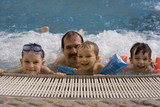 family in jacuzzi poster