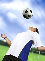 footballer chesting the ball