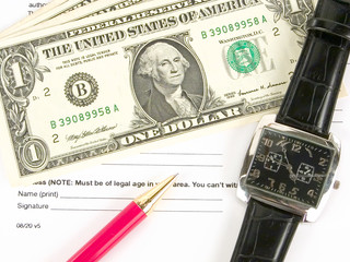 us dollars, pen and expensive watch