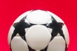 white soccer ball on a red background