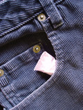 tampon tucked into front pocket of ladies jeans poster