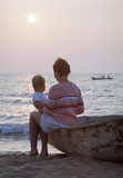 mother and baby on a beach poster