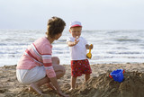 mother and child on a beach poster