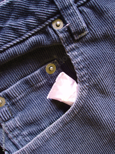 tampon tucked into front pocket of ladies jeans