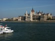 river of danube with ship and hungarian parliament