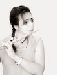 beautiful woman playing flute