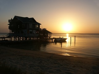 house with sunset on roatan island