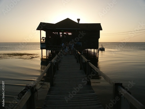 sunset on roatan island with house