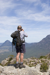 old man photographer on mountain top 2