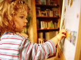 little girl & blackboard poster