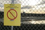 danger warning sign with navajo language erased poster