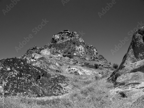 poster of mountain top in black and white
