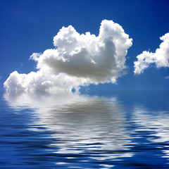 blue sky & clouds reflected in water