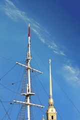 jury-masts and rope of sailing ship with the spire of the peter