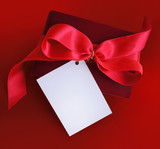 present with red ribbon and card. poster