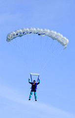 parachutist or skydiver coming in to land