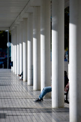 pillars and modern architecture with people sitting