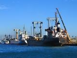 cargo ships docked for loading poster