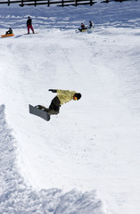 snowboarder on half pipe of ski resort in spain
