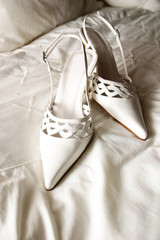 ladies high heeled white leather shoes