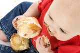 baby girl eating muffins poster