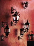 red wall with lamps poster