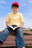 sitting boy with book poster