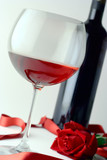 wine glass, bottle and red rose poster