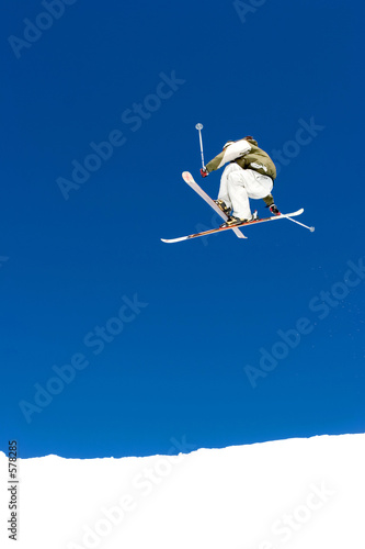 man skiing on slopes of ski resort in spain