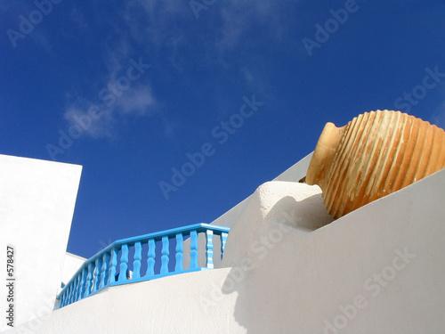 vase set in whitewashed wall, santorini, greece
