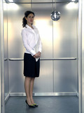 office worker in lift poster