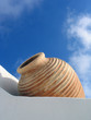 white wall, beige vase, blue sky, santorini, greec