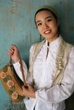 asian woman holding a handbag poster