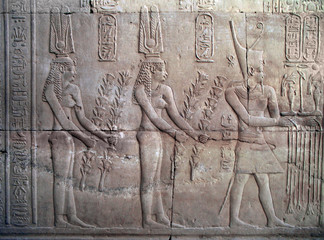 pharaoh and two women, temple of kom ombo, egypt