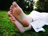 bare feet on the grass poster