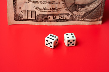 ten dollar and dices, on a red background