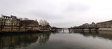 france, paris: seine river, pont des arts in winter poster