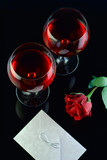 wine glasses, rose and a letter poster