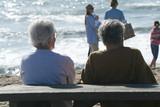 elderly couple on the beach poster