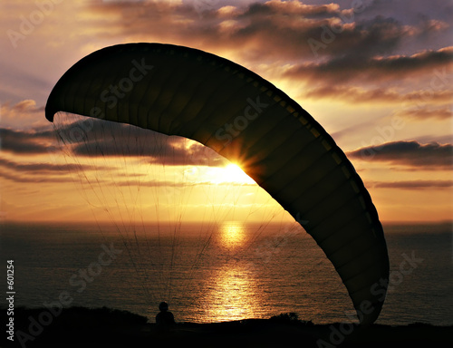 hang glider against sunset
