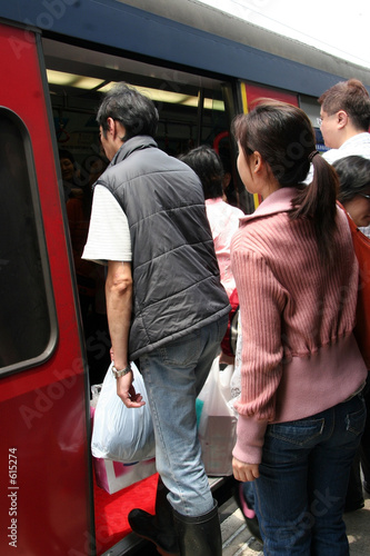 people boarding a train