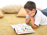 boy reading a book on the floor poster