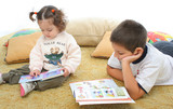 brother and sister reading books on the floor poster