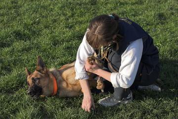 woman cutting dog nails