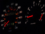 glowing car spedometer, tachometer in darkness