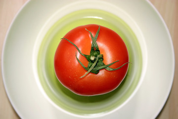 tomato in a plate.