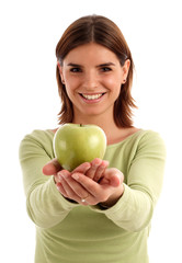 stock photo of a young woman holding green apple