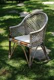 old  white garden chair in a grass floor poster