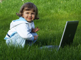 girl with notebook on grass poster