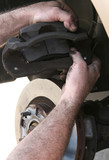 new brake pads in caliper poster